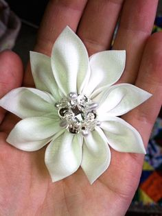 Tsumami hair flower, center made from extra jewels/beads that came with wedding dress