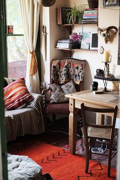cozy space - wood, handmade textiles, earth tones, pops of color, plants, organic materials.