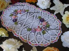 This doily is 21x14. Hand crocheted out of size 10 100% cotton crochet threads. The doily pictured is for your reference on the design. When