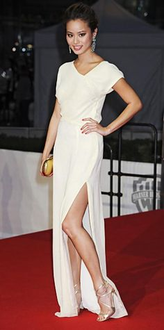 MAY 27, 2011 Jamie Chung WHAT SHE WORE For the Berlin premiere of Hangover 2, up-and-comer Chung accented a high-slit white gown with golden Jimmy Choo sandals and shoulder-dusting turquoise earrings from House of Lavande.