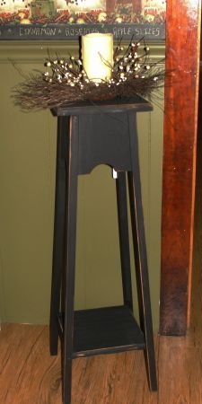 I have painted this candle stand in black and distressed it for a prim look. I have photographed it with a candle arrangement but you could use it as a accent table for a light etc...    Candle and wreath are NOT included in this  product, for photo purposes only.    Measures 32 h x 10.5 x 10.5   TYPE CANDLESTAND COLOR OPTIONS IN BOX:   Black  Ivory   Ivory over Black  Burgundy   Burgundy over Black