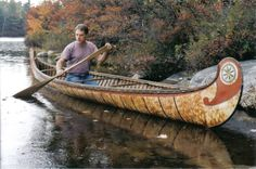 18 foot Fur-Trade style birch bark canoe  with typical painted  decoration and fancy root sewng on bows . This type  of bark canoe was built from the 1600s to the early 1900s  by both Indian and French craftsmen for Canadian government and military purposes ,as well as  for the fur-trade