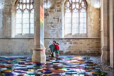 Reflecting the architecture of the former St. John's Church in North Lincolnshire, UK is Liz West's site-specific pool of over 700 multi-colored orbs title
