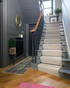 Grey walls with black doors are brought to life with brass accents and a pink rug. Original Victorian balustrade has been returned to its original splendour in black cast iron. a diagonal herringbone oak floor adds further character. Future House, My House, Open House, House Staircase, Black Staircase, Staircase Design, Victorian Hallway, Hallway Inspiration, Stair Landing