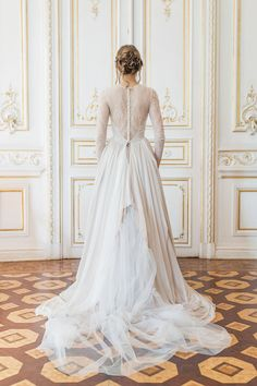 Nude wedding gown with hand draped skirt and crystal embroidery on the lace bodice | Cathy Telle