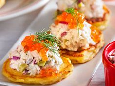 Potato blini with crab salad    All dressed up, these dainty little blini pancakes will get the party started. Made with mashed potato instead of traditional buckwheat, they're lovely, light and fluffy!