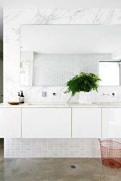 Love her design style. Love the modern copper wire basket and the fern in the white crumple ceramic vase. Get the look at TILE junket Laundry In Bathroom, Bathroom Style, Marble Bathroom, Vanity Tray Decor, Home, Trendy Bathroom, Bathroom Styling, Bathroom Design, Beautiful Bathrooms