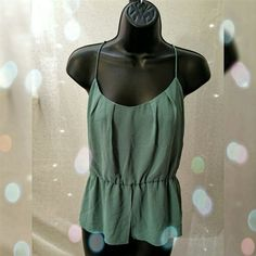 Sea green teal racer back peplum blouse Tank top, chiffon type of material (not sure the proper name for this) New no tags   I do not trade  I do not model the items in my closet  no offline payments  no other accounts  ✔ open to REASONABLE offers please use the offer button  Tops Blouses