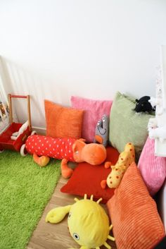 Use oversized pillows for seating in reading nook, the cozier the better!