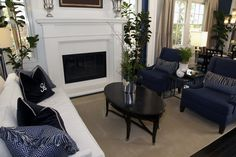Swanky living room design in royal blue and white. Check out 46 more swanky living room designs at