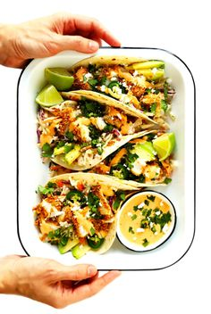 This Crispy Baked Fish Tacos recipe is made with the yummy panko-crusted fish, zesty cilantro-lime slaw, a super-simple chipotle crema, and whatever other toppings (hello, avocado) you love most. Baked Fish Tacos, Oven Baked Fish, Crispy Tacos, Grilled Fish, Grilled Salmon, Sin Gluten, Best Fish Taco Recipe, Chipotle Crema, Cilantro Lime Slaw
