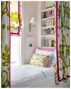 Bookshelf head board.  Curtains all around.  Next to window...  Perfect reading nook by day, cozy bed by night.