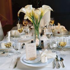 .:Keep Your Setting Neutral:. For a table that makes a statement, set it with a single color. The food will take centerstage on this all-white table. White linens and candles pair prettily with a calla lily centerpiece.