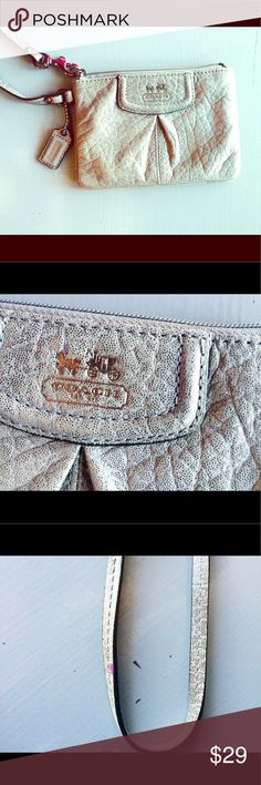 Coach Madison Glitter Wristlet Authentic Coach wristlet wallet in taupe with glitter throughout for a slight shimmer. Excellent condition aside from a small spot of purple nail polish on the strap. 😍 Coach Bags Clutches & Wristlets