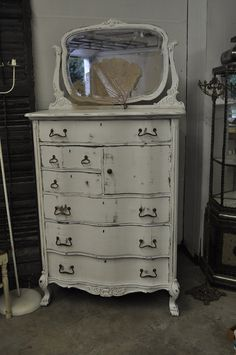 Would you like to come have a new life at my house? Lovely vintage white dresser and mirror