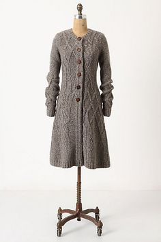 sweater coat - love the deteriorating cables down the back :)