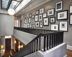 Tips and Ideas for Hanging Pictures and Gallery Wall Layouts - We've put together a comprehensive How-To packed with tips and ideas for creating art gallery walls, also known as picture walls and display walls, using a hanging system. With some fine layout examples from houzz.com, Pottery Barn, Better Homes and Gardens, and Southern Living, you'll be able to create any design you like, and change it anytime you choose, without putting nails in your walls.