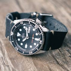 """Story  The venerable Seiko 200m Diver has been called """"one of the greatest, most humble watches in the industry,"""" and who are we to disagree?  With bullet-proof dependability and classic good looks, its lineage has been the timepiece of choice by guys like Robert Redford, Mick Jagger, and Martin Sheen for nearly a half a century. Iterations past and present have traveled to extreme depths, sailed the high seas, fought in the jungles of Vietnam, and now it's back by very popular dem..."""