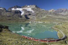 Bernina Express scenic train passing a lake in Switzerland