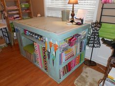 A home made cutting table . . love the fabric storage underneath.