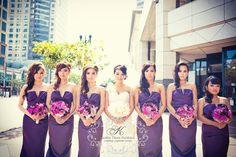 purple bridesmaids dress with purple/magenta bouquets