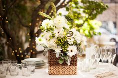 Woven Basket Centerpiece - 24 Best Ideas for Rustic Wedding Centerpieces (with Lots of Picture Inspiration) - EverAfterGuide