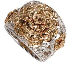 18k gold ring with white and brown diamonds