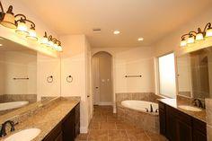 Waterfront Southlake Home Ready for Move-In - 4,560 Sq. Ft. - Master Bathroom - #PerryHomes #trustedbuilder #Southlake #Pearland #AlvinISD #TexasMedicalCenter #TexasMedCenter #PearlandTownCenter #PearlandHomes #HoustonHomes #realestate #openconcept #openfloorplan #waterfronthome #lakesidehome #lakefronthome  #design #newhome #relocatingtohouston #southhouston #lakesidecommunity #interiordesign #masterbathroom #mastersuite #masterretreat #gardentub #tilefloor