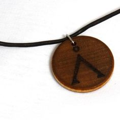 Stargate SG1 Necklace Earth Glyph Wood Burned by KnottySis on Etsy, $8.00