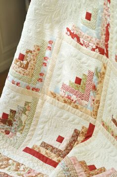 My Log Cabin with a honey bun and fig tree quilt fabric