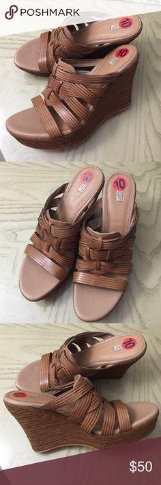 """🍂UGG 🍂'Melinda' Platform Wedge Sandal 🍂UGG 🍂'Melinda' Platform Wedge Sandal    Approx 4 1/4"""" heel; 1 1/2"""" platform (size 10). PORON® cushioned footbed. Leather upper and lining/rubber sole. By UGG; imported. UGG Shoes Wedges"""