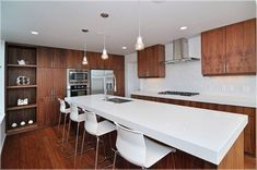 l shaped kitchen with island and dining table. kitchen island ideas with wheels #kitchenislandideas