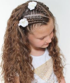 I love waves from braids the day before. To show off those waves, we put in little braids with angled part lines. We did a dutch infinity braid and a 5 strand dutch braid and finished it off with little flower clips.