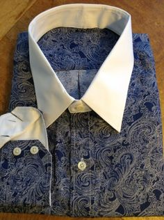 Beautiful Blue Paisley with white contrasting collar and cuff interior.
