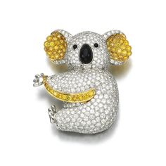 Diamond and onyx brooch, Graff Designed as a koala bear, pavé-set with brilliant-cut diamonds of yellow and near colourless tints, enhanced with polished onyx eyes and nose, unsigned, one small diamond deficient, case stamped Graff.