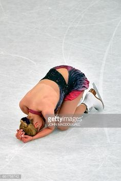 Russia's Anna Pogorilaya reacts after falling three times during her routine in the woman's Free Skating event at the ISU World Figure Skating Championships in Helsinki, Finland on March 31, 2017. / AFP PHOTO / John MACDOUGALL (Photo credit should read JOHN MACDOUGALL/AFP/Getty Images)
