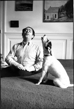 Roland Topor and his dog singing some tunes