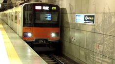 Train arriving at Motomachi-Chukagai Station, Yokohama, Japan.