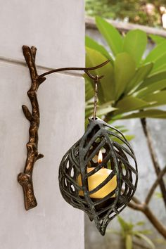 Love this Leaf wall candle holder for outdoors under the covered patio.