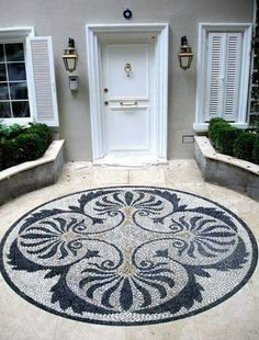 Stones and pebbles are not only to adorn walk ways and path ways only you can actually highlight any of your dull and boring outdoor spot by building awesome stone designs. This is a perfect design to give your front door a lavish and grand look. Its perfectly warm and welcoming.
