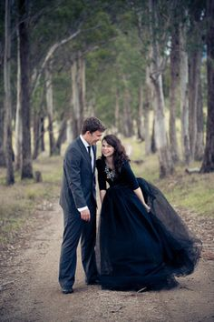 Can you believe this gown is totally DIY?! http://www.stylemepretty.com/2014/10/31/an-ode-to-halloween-our-favorite-black-gowns/ | Photography: Jenny Cuerel
