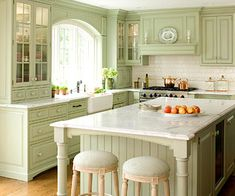 I like the green and the cabinets, beadboard on the island, etc. The whole thing is warm and inviting.