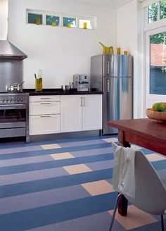 Interior, : Gorgeous Kitchen Design Idea With White Kitchen Cabinet Designed With Black Top Plus Fridge And Stove Combine With Brown Wooden Dining Table Also White And Blue Stripes Marmoleum Floor