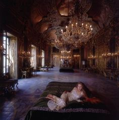 Title:San Vicenzo   Caption:1984, Donna Stefanella Vanni Calvello di San Vicenzo in the Hall of Mirrors at her family's palazzo in Palermo, Sicily. The focal point of Sicilian Belle-Epoque society, this eighteenth-century palazzo has been compared with Versailles.       Artist:Slim Aarons  Date:1984