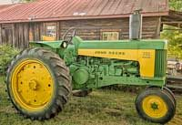 This 1960 Model 730 Diesel, Electric Start, John Deere is owned my Douglass K. Britt, McCormick, SC. This classic 730, one of the last produced by John Deere's Waterloo factory in 1960 when production ceased on all US built 2 cylinder tractors.