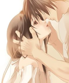 Anime couple about to kiss.