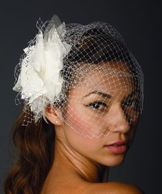 Love in Cannes bridal birdcage veil with flower fascinator. $70.00, via Etsy.