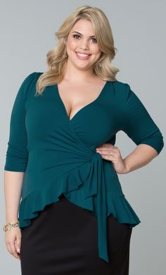 Feminine and flirty, our plus size Laila Wrap Top flatters every shape.  Designed with a slight hi-lo like ruffled hem for style and a true wrap design for easy fit.  www.kiyonna.com  #KiyonnaPlusYou  #Plussize  #MadeintheUSA  #Kiyonna