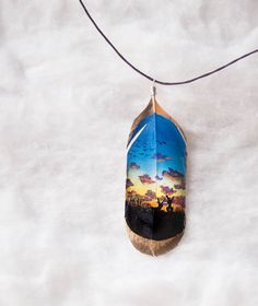 Rabbits in love: Hand painted feather jewerly by hoyhenenkevytta on Etsy