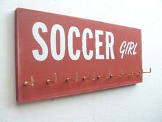 Hey, I found this really awesome Etsy listing at http://www.etsy.com/listing/98474720/soccer-soccer-medals-hanger-in-10-colors